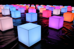 glowing squares on black background