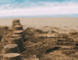 7 sandcastles on a beach