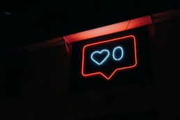 stock image of neon sign representing social media