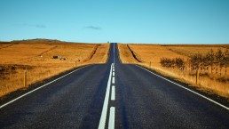 stock image of long road to portray continuity