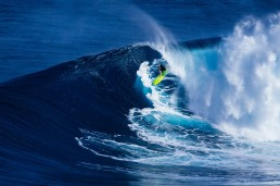 Image of a surfer riding a wave