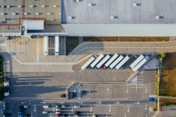 stock image of a warehouse and lorries