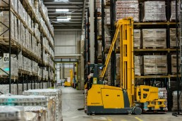 Stock image of a warehouse and forklift