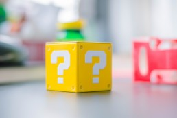 Stock image of a cube with questions marks on it