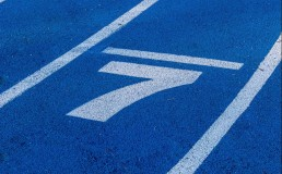 Image of number 7 written on tarmac running track