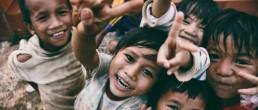 Children smiling into camera