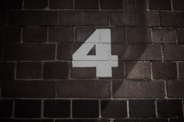 stock image of a a number 4 painted on a brick wall
